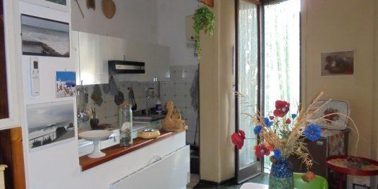 V20 Appartamento con giardino piastrellato